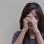 stock-footage-woman-praying-with-holy-cross